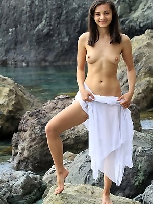 Sima is innocently sexy while losing in the wilderness with perky breasts